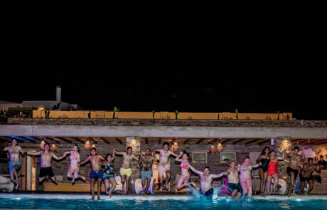 Destination Wedding in Greece guests jumping into pool