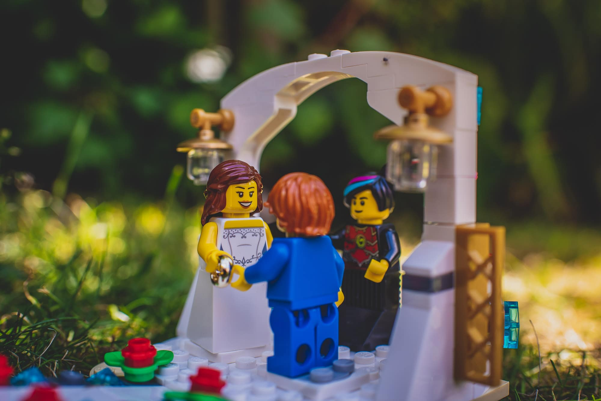 Groom puts ring on the lego Bride's ring finger