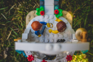 A shot from above of the Lego Wedding couple exchanging wedding bands